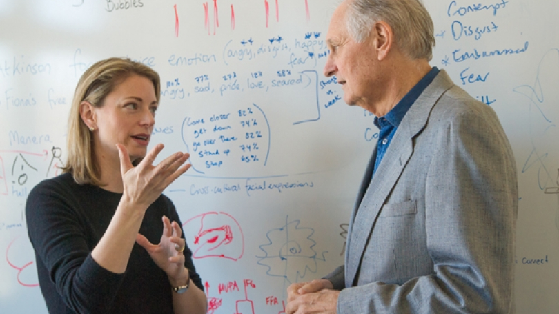 Professor Thalia Wheatley discusses her research with actor Alan Alda during his visit to campus in April 2012. (Photo by Eli Burakian '00)