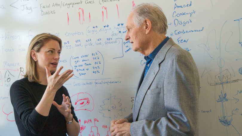 Associate Professor Thalia Wheatley talks with actor Alan Alda in her lab in the department of Psychological and Brain Science. (Photo by Eli Burakian '00)