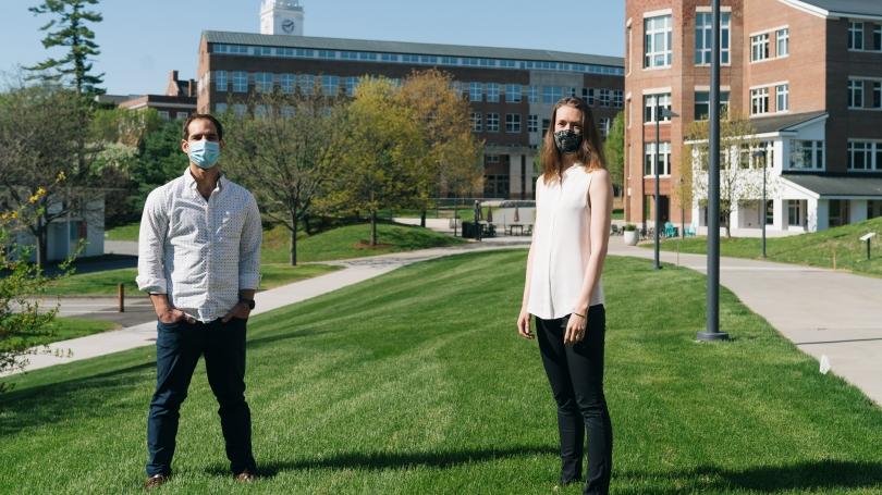 Adam Steel and Caroline Robertson standing outside, masked